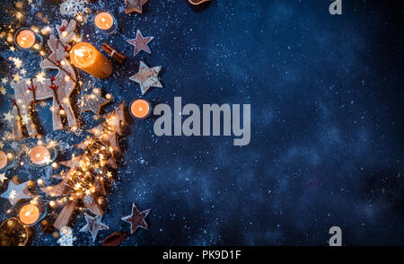 Christmas background with wooden decorations and candles. Free space for text. Celebration and decorative design. - Stock Photo