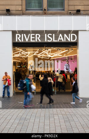 People walking past a River Island store in Church St Liverpool UK. - Stock Photo