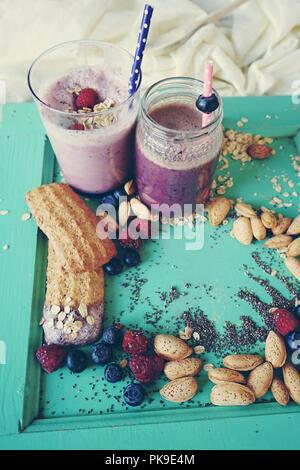 Healthy breakfast with  berries milkshake, fruits and grains - Stock Photo