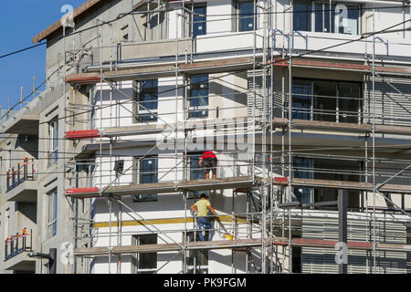Installing insulation on a new built building, Bron, France - Stock Photo