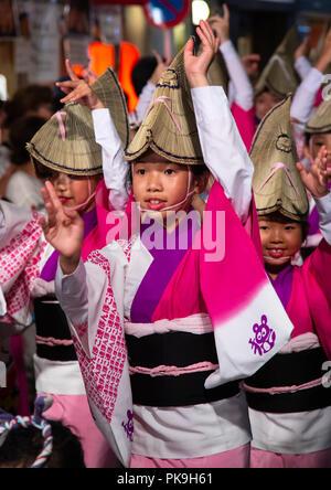 Japanese children with straw hats during the Koenji Awaodori dance summer street festival, Kanto region, Tokyo, Japan - Stock Photo