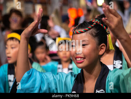 Japanese children during the Koenji Awaodori dance summer street festival, Kanto region, Tokyo, Japan - Stock Photo