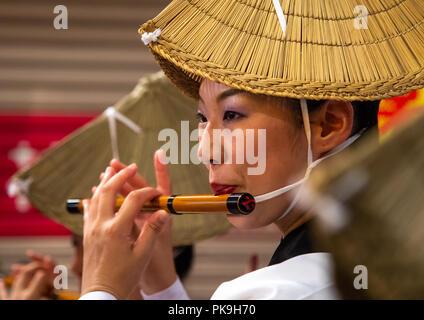 Japanese woman with straw hat during the Koenji Awaodori dance summer street festival, Kanto region, Tokyo, Japan - Stock Photo