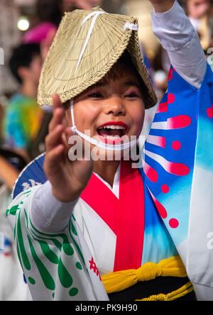Japanese girl with straw hat during the Koenji Awaodori dance summer street festival, Kanto region, Tokyo, Japan - Stock Photo