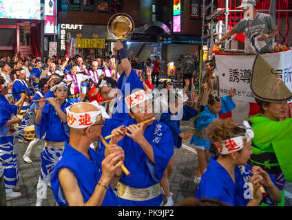 Japanese musicians during the Koenji Awaodori dance summer street festival, Kanto region, Tokyo, Japan - Stock Photo