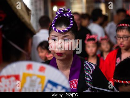 Japanese dancers during the Koenji Awaodori dance summer street festival, Kanto region, Tokyo, Japan - Stock Photo