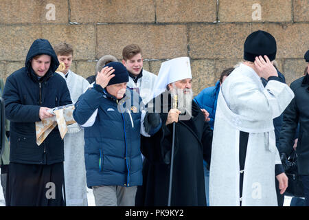 Saint Petersburg. Russia - January 12, 2018: Metropolitan Varsonofy of St. Petersburg and Ladoga with other people go to Ice-hole on Epiphany day. Tra - Stock Photo