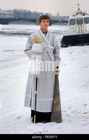 Saint Petersburg. Russia - January 12, 2018 Young churchman on the street on Epiphany day. - Stock Photo