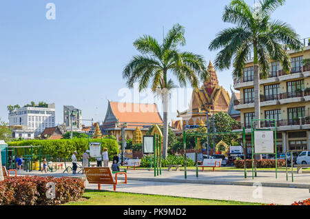 Phnom Penh, Cambodia - April 9, 2018: Preah Sisowath Quay - the boulevard running along the banks of the Mekong and Tonle Sap rivers and the most popu - Stock Photo