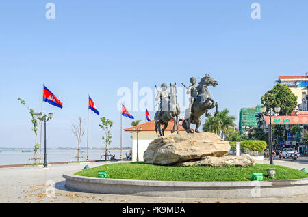 Phnom Penh, Cambodia - April 9, 2018: View of the Preah Sisowath Quay with the horse monument to the warriors Techo Meas and Techo Yot - Stock Photo