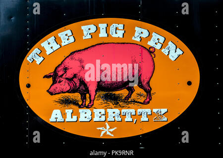 Texas BBQ pig sign in small town Albert - Stock Photo