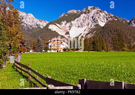 Mountains, buildings and fields around San Vigilio di Marebbe, Italy - Stock Photo