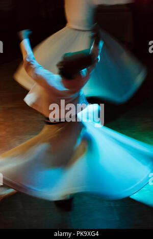 Whirling dervishes dancing, Istanbul, Turkey - Stock Photo