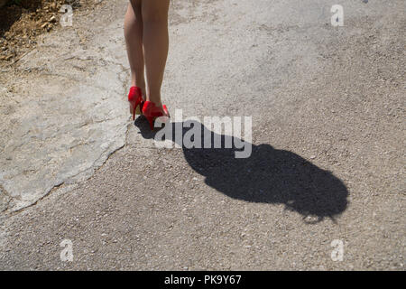Woman's shadow walking on the street - Stock Photo