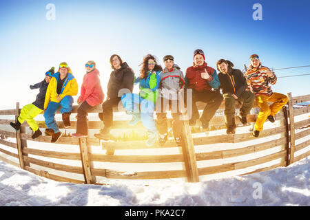 Group of friends at ski resort. Winter vacations concept with group of skiers and snowboarders - Stock Photo