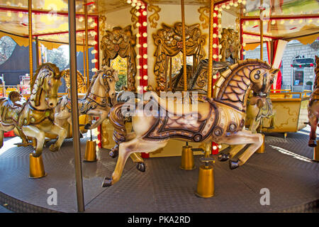 Old fashioned french carousel with horses - Stock Photo