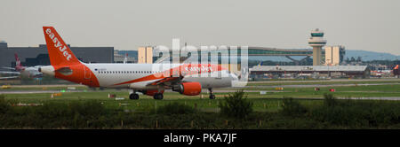 GATWICK AIRPORT, ENGLAND, UK – AUGUST 30 2018: An easyJet Airlines plane prepares to take off from Gatwick Airport. - Stock Photo