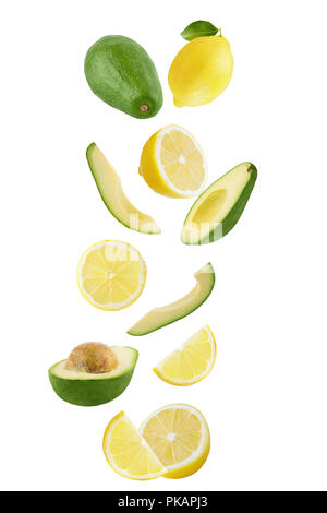 Isolated flying fruits. Falling fresh lemon and avocado isolated on white background with clipping path as package design element and advertising. - Stock Photo