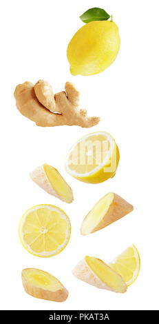 Isolated flying fruits. Falling lemon and ginger isolated on white background with clipping path as package design element and advertising. - Stock Photo