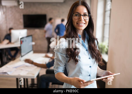 Portrait of young beautiful architect in office - Stock Photo