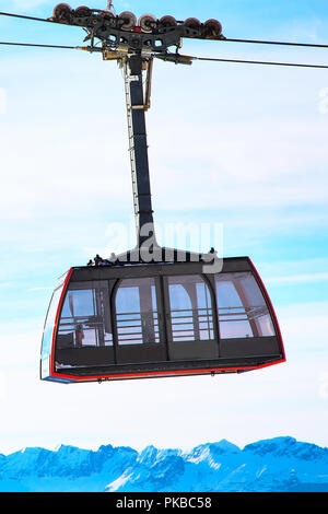 Red Cable Car from Chamonix to the summit of the Aiguille du Midi, France close up and mountains - Stock Photo