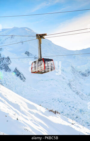 Chamonix, France - January , 28, 2015: Cable Car Telepherique Auguille du Midi and snow mountains - Stock Photo