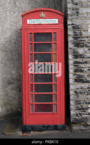 Defibrillator Uk in an old fashioned traditional red telephone box now no longer in use for making phone calls but used to keep defibrillators for public use. England 2010s. HOMER SYKES - Stock Photo