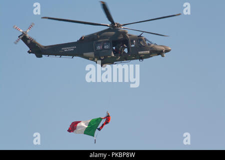 Helicopter flying with Italian flag at an airshow - Stock Photo