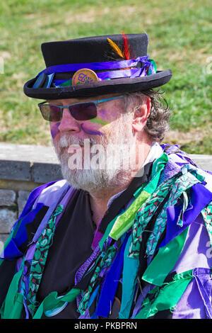 Morris dancer, member of Wicket Brood Border Morris at the Swanage Folk Festival, Swanage, Dorset UK on a lovely warm sunny day in September - Stock Photo