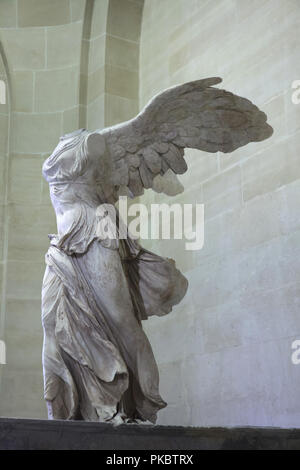 Hellenistic marble statue known as the Winged Nike of Samothrace dated from the 2nd century BC on display in the Louvre Museum in Paris, France. - Stock Photo
