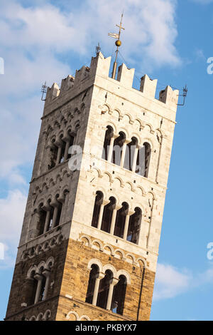 Bell tower of the Cathedral of San Martin in the Piazza San Martino; Lucca, Tuscany, Italy - Stock Photo