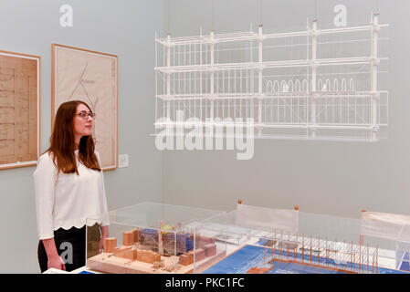 London, UK.  12 September 2018.  A staff member views a design for the Centre Georges Pompidou in Paris, France, at a preview of 'Renzo Piano: The Art of Making Buildings', an exhibition of works by the internationally renowned architect and Honorary Royal Academician Renzo Piano.  An overview of 16 of his most significant projects are on display in an exhibition which runs 15 September to 20 January 2019 at the Royal Academy of Arts in Piccadilly.  Credit: Stephen Chung / Alamy Live News - Stock Photo