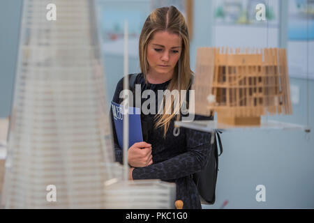 London, UK. 12th Sep, 2018. Studying models forthe Shard - Renzo Piano: The Art of Making Buildings in the Gabrielle Jungels-Winkler Galleries of the Royal Academy of Arts. Piano is an architect and Honorary Royal Academicianand this is the first comprehensive survey of hiss career to be held in London since 1989 - forming part of the 250th anniversary of the Royal Academy. Credit: Guy Bell/Alamy Live News - Stock Photo