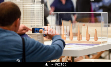 London, UK.  12 September 2018. A visitor photographs models of The Shard, London, at a preview of 'Renzo Piano: The Art of Making Buildings', an exhibition of works by the internationally renowned architect and Honorary Royal Academician Renzo Piano.  An overview of 16 of his most significant projects are on display in an exhibition which runs 15 September to 20 January 2019 at the Royal Academy of Arts in Piccadilly.  Credit: Stephen Chung / Alamy Live News - Stock Photo
