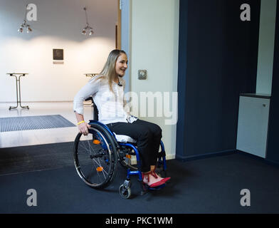 Berlin, Germany. 12th Sep, 2018. The paraplegic Olympic cycling champion Kristina Vogel comes to a press conference in a wheelchair at the Trauma Hospital Berlin-Marzahn. After a training crash on June 26, Vogel will be treated at the special clinic in Berlin. Credit: dpa picture alliance/Alamy Live News - Stock Photo