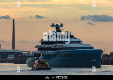 Gravesend, United Kingdom. 12th September, 2018. State-of-the-art superyacht Aviva which belongs to billionaire Spurs owner Joe Lewis pictured heading down the Thames at Gravesend shortly before sunset with the Port of London Authority pilot boat about to come alongside.  The 321 feet long multi-million pound mega yacht is believed to feature a full-size tennis court and can accommodate up to 16 guests.  Rob Powell/Alamy Live News - Stock Photo