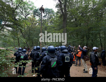 13 September 2018, North Rhine-Westphalia, Kerpen: Police officers are standing in the Hambach Forest. Authorities want to start evictions in the Hambach Forest. Photo: Oliver Berg/dpa - Stock Photo