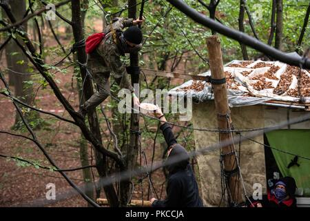 13 September 2018, North Rhine-Westphalia, Kerpen: Activists have breakfast while guarding their tree houses. Authorities want to start evictions in the Hambach Forest. Photo: Jana Bauch/dpa - Stock Photo