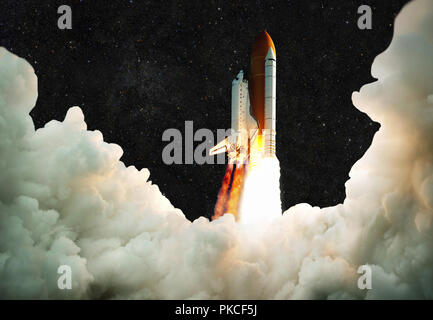 Spaceship takes off into space. Rocket flies on a background of the starry sky - Stock Photo