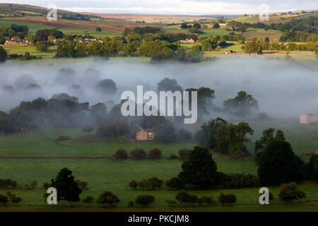 The Tees Valley and the View Towards the Village of Mickleton From Whistle Crag on a Misty Morning, Middleton-in-Teesdale, County Durham, UK - Stock Photo
