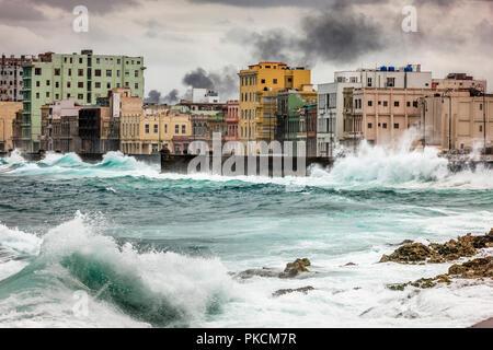 Havana, Cuba. 18th January 2013. Waves from a winter storm crash against the Malecon wall in Havana, Cuba. - Stock Photo