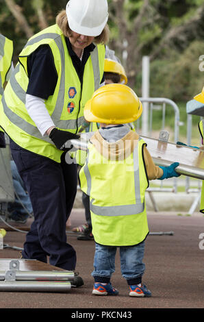 Children helping to build bridge at Institute of Civil Engineers stand at Riveting Stuff festival UK - Stock Photo