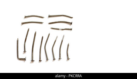 Deformed used metal nails on a white background. close-up photo, copy space - Stock Photo