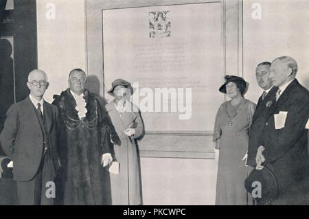 'After The Reopening of the Reconstructed Dome, 14th September 1935', (1939). Henry D Roberts (left), the Mayor of Brighton, Sidney Gibson and dignitaries after renovations. The Dome in Brighton, Sussex, was originally built by the Prince Regent as a stable block. It was used as a Victorian skating rink, a military hospital during the First World War, and most recently a performing arts venue. From A History of the Royal Pavilion, Brighton, by Henry D. Roberts. [Country Life Limited, London, 1939] - Stock Photo