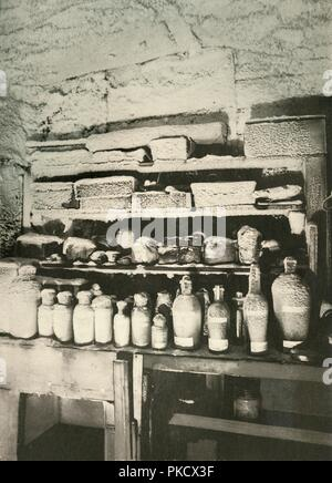 'Mawson's Chemical Laboratory. The bottles were coated with ice by condensation from the warm, moist air of the hut', c1908, (1909). The frozen laboratory of expedition physicist Douglas Mawson. Anglo-Irish explorer Ernest Shackleton (1874-1922) made three expeditions to the Antarctic. During the second expedition, 1907-1909, he and three companions established a new record, Farthest South latitude at 88°S, only 97 geographical miles (112 statute miles, or 180 km) from the South Pole, the largest advance to the pole in exploration history. Members of his team also climbed Mount Erebus, th - Stock Photo