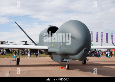 United States Air Force Northrop Grumman RQ-4B Global Hawk serial number 04-2015 which is an unmanned surveillance aircraft on display at an airshow. - Stock Photo
