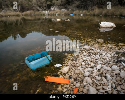Rubbish in a small pond near Plat on the island Cres, Croatia - Stock Photo