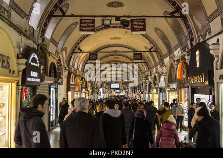 ISTANBUL, TURKEY - DECEMBER 30, 2015: Crowded street in the Grand Bazaar during rush hour. The Grand Bazaar is one of the main landmarks of the city,  - Stock Photo