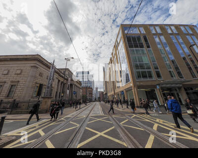Tram tracks on Mosley Street in Manchester - Stock Photo