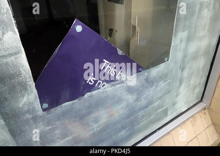 Closeup of Bank closure signs in ex bank window at a Nat West Bank Closed in Dinnington, South Yorkshire - Stock Photo